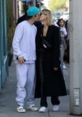 Hailey Bieber and Justin Bieber share a kiss while out for a stroll in West Hollywood, California