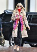Heidi Klum dons a cool graffiti coat as she arrives at America's Got Talent in Pasadena, California