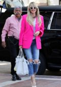 Heidi Klum rocks a hot pink blazer as she arrives at 'America's Got Talent' in Pasadena, California