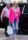 Heidi Klum rocks a hot pink blazer as she arrives at 'America's Got Talent' in Pasadena, California