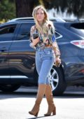 Hilary Duff looks great in knee-high boots and skin-tight jeans on an Alfred Coffee run in Studio City, California