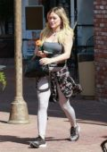 Hilary Duff looks great in Nike leggings and a grey tank top as she leaves the gym in Studio City, California