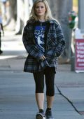 Holly Madison wears a checkered flannel shirt and leggings while out for a walk in Studio City, California