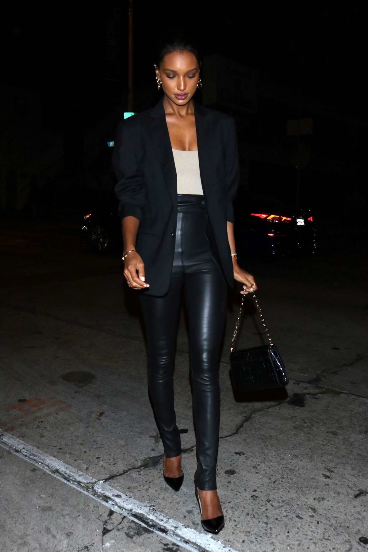 Jasmine Tookes looks great in a black blazer and leather pants during a night out at Craig's in West Hollywood, California
