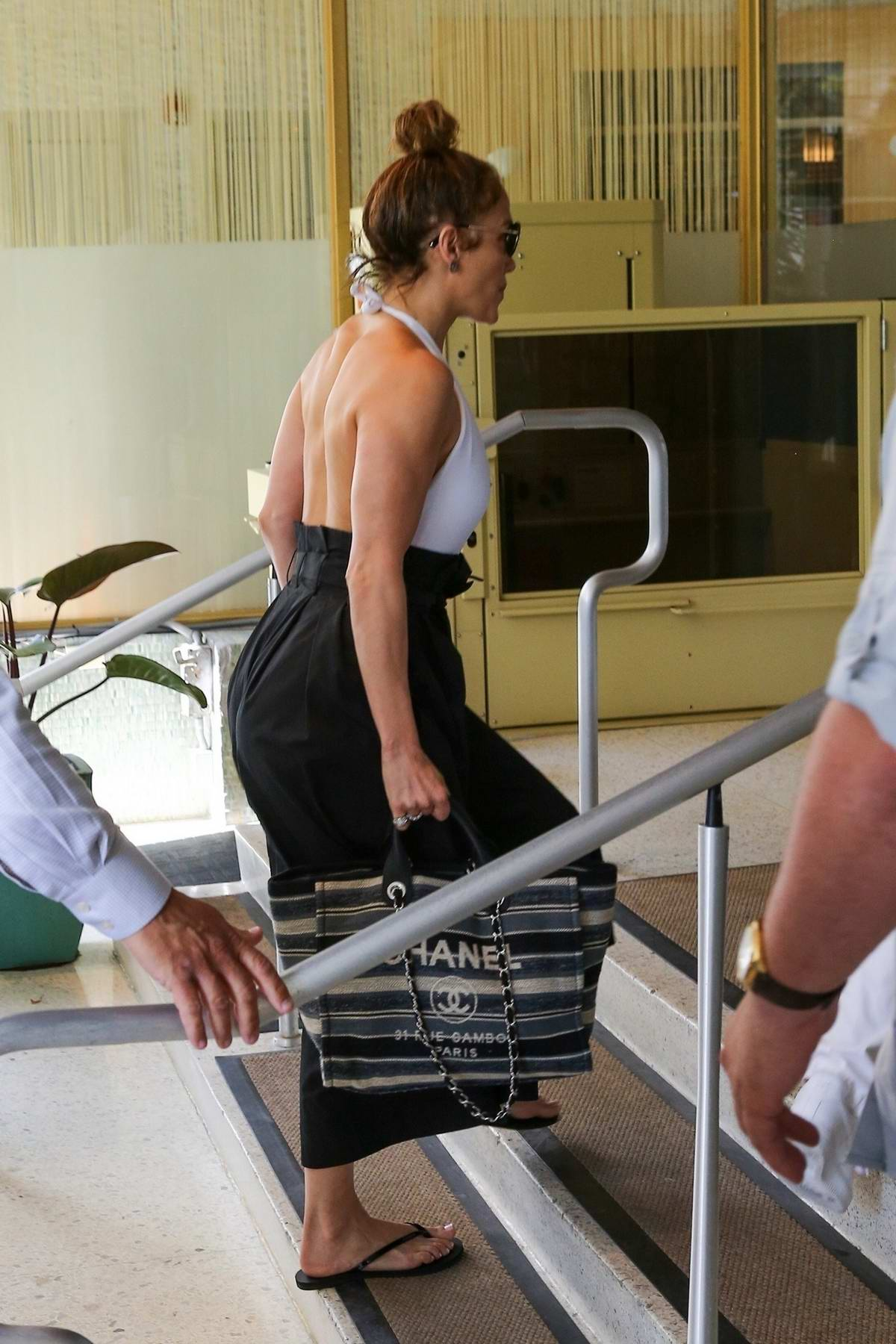 Jennifer Lopez seen wearing a backless outfit as she heads to lunch at the Standard Hotel in Miami, Florida