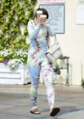 Joey King covers her face during a coffee run while sporting a tie-dye top and leggings in Studio City, California