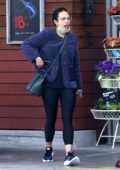 Jordana Brewster snacks on some food while out for grocery shopping in Brentwood, California