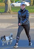 Jorgie Porter seen wearing a puffer jacket and leggings for an early morning jog with her dog in Manchester, UK