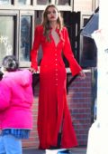 Josephine Skriver looks gorgeous in red while filming a Maybelline commercial in New York City