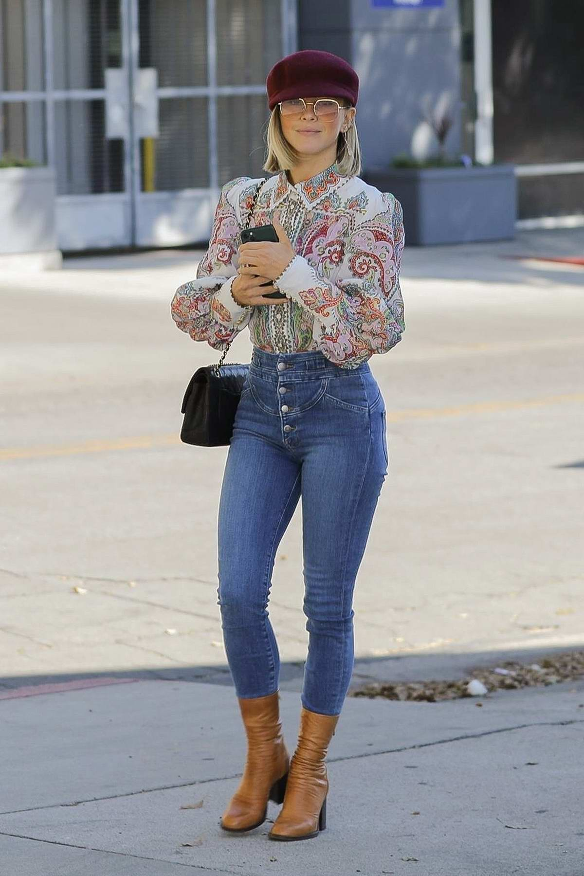 Julianne Hough looks happy during a lunch outing with a friend in Los Angeles