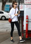 Kaia Gerber shows off her long slender legs in black leggings as she leaves the gym in Los Angeles