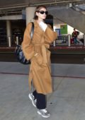 Kaia Gerber spotted after Paris Fashion Week as she touches down LAX in Los Angeles