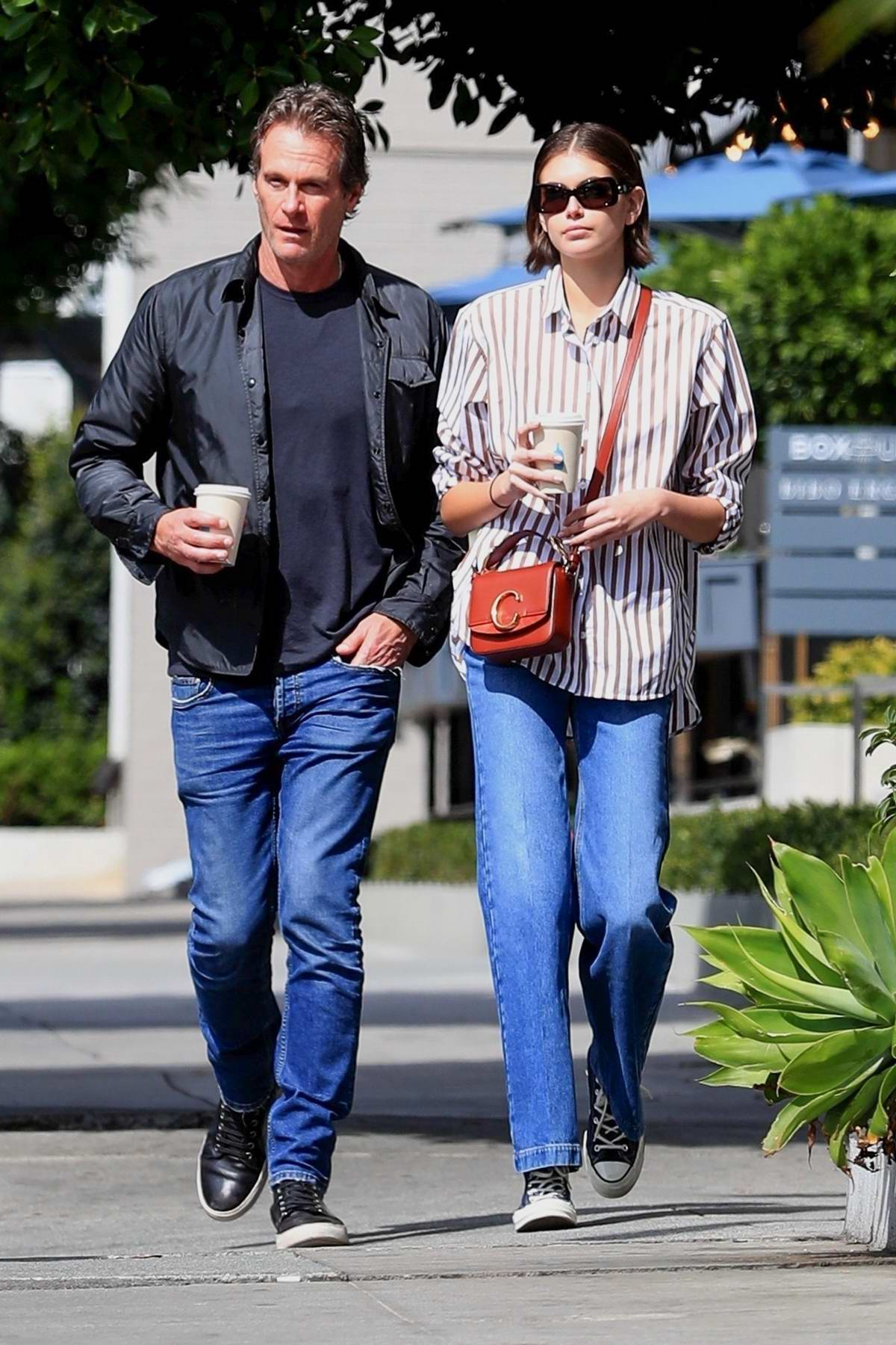 Kaia Gerber steps out for some coffee with her dad Rande Gerber in West Hollywood, California