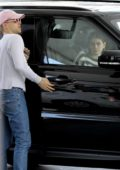 Kaia Gerber waits in the car as one of her friend's gasses up her ride during an afternoon outing together in Los Angeles