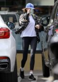 Kaia Gerber wears a plaid shirt, leggings and wrist support as she picks up a smoothie at Earthbar in West Hollywood, California