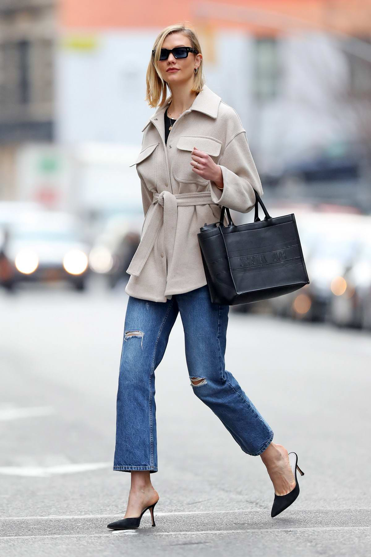 Karlie Kloss looks stylish in a beige jacket and jeans as she steps out in New York City