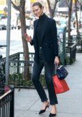 Karlie Kloss puts on a stylish display in a dark blue blazer and jeans while out in New York City