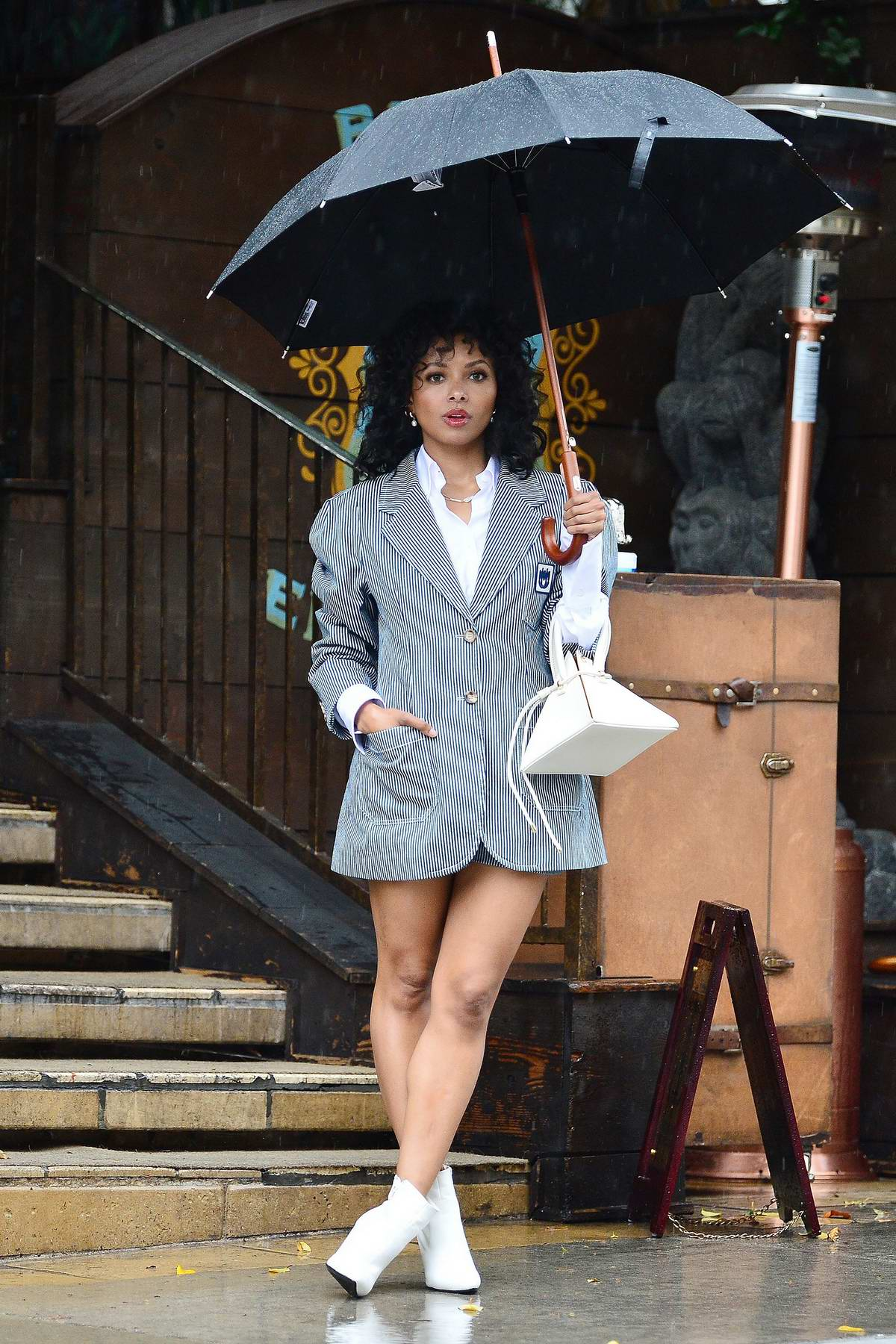 Kat Graham puts on a leggy display while leaving Petit Ermitage hotel in the rain in West Hollywood, California
