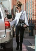 Kate Beckinsale shows off her fit figure in black leggings as she exit a medical building in Los Angeles