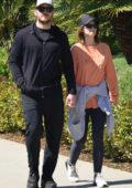 Katherine Schwarzenegger and Chris Pratt hold hands as they go for a walk in Santa Monica, California
