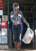 Katy Perry carries her pup Nugget in her hoodie while shopping at CVS Pharmacy in Los Angeles
