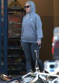 Katy Perry spotted in a grey hoodie and leggings while stopping by a gas station in Los Angeles