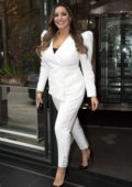 Kelly Brook looks great in a white suit as she leaves the Ivy Club in London, UK