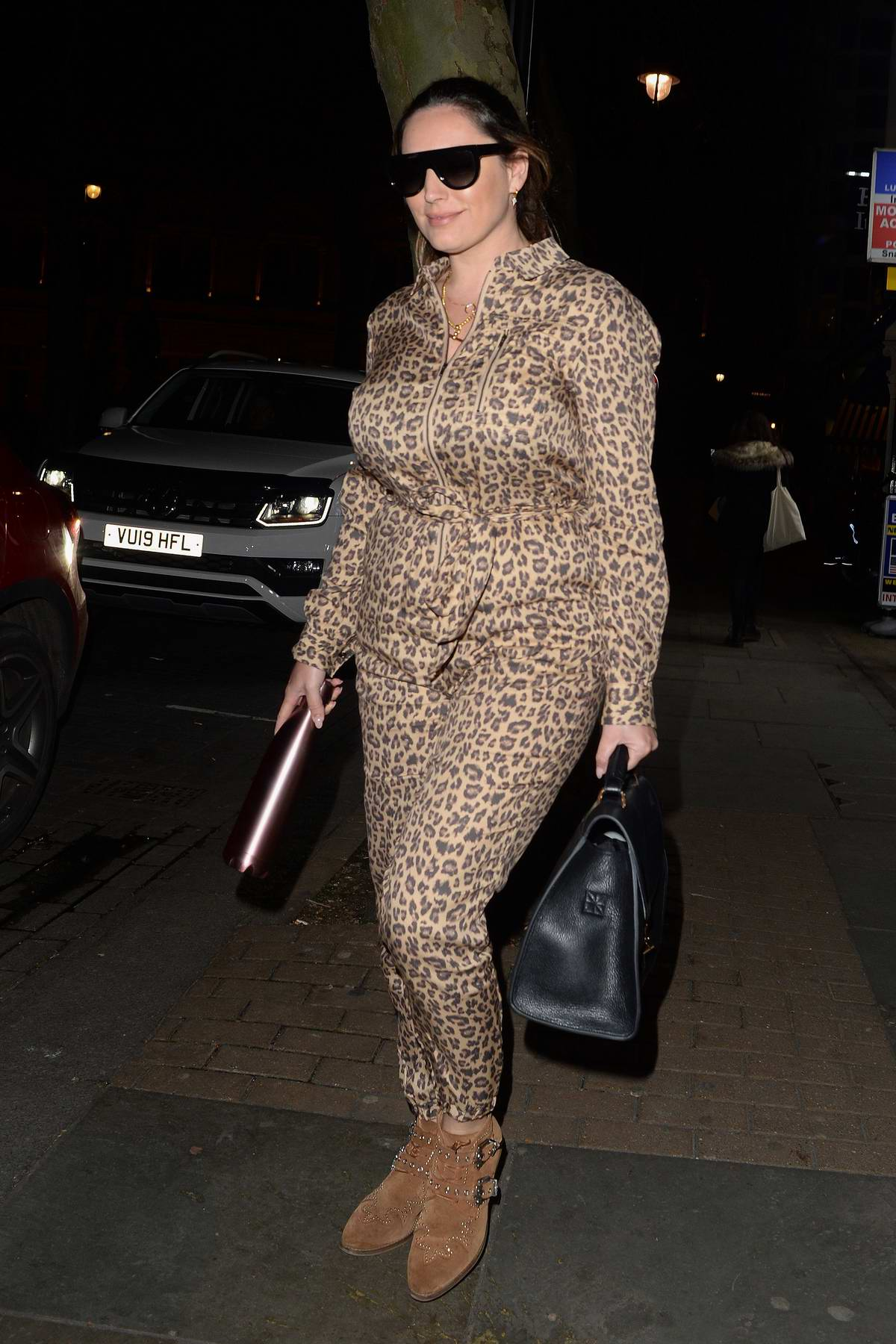 Kelly Brook looks great in an animal print jumpsuit as she leaves the Global Radio Studios in London, UK