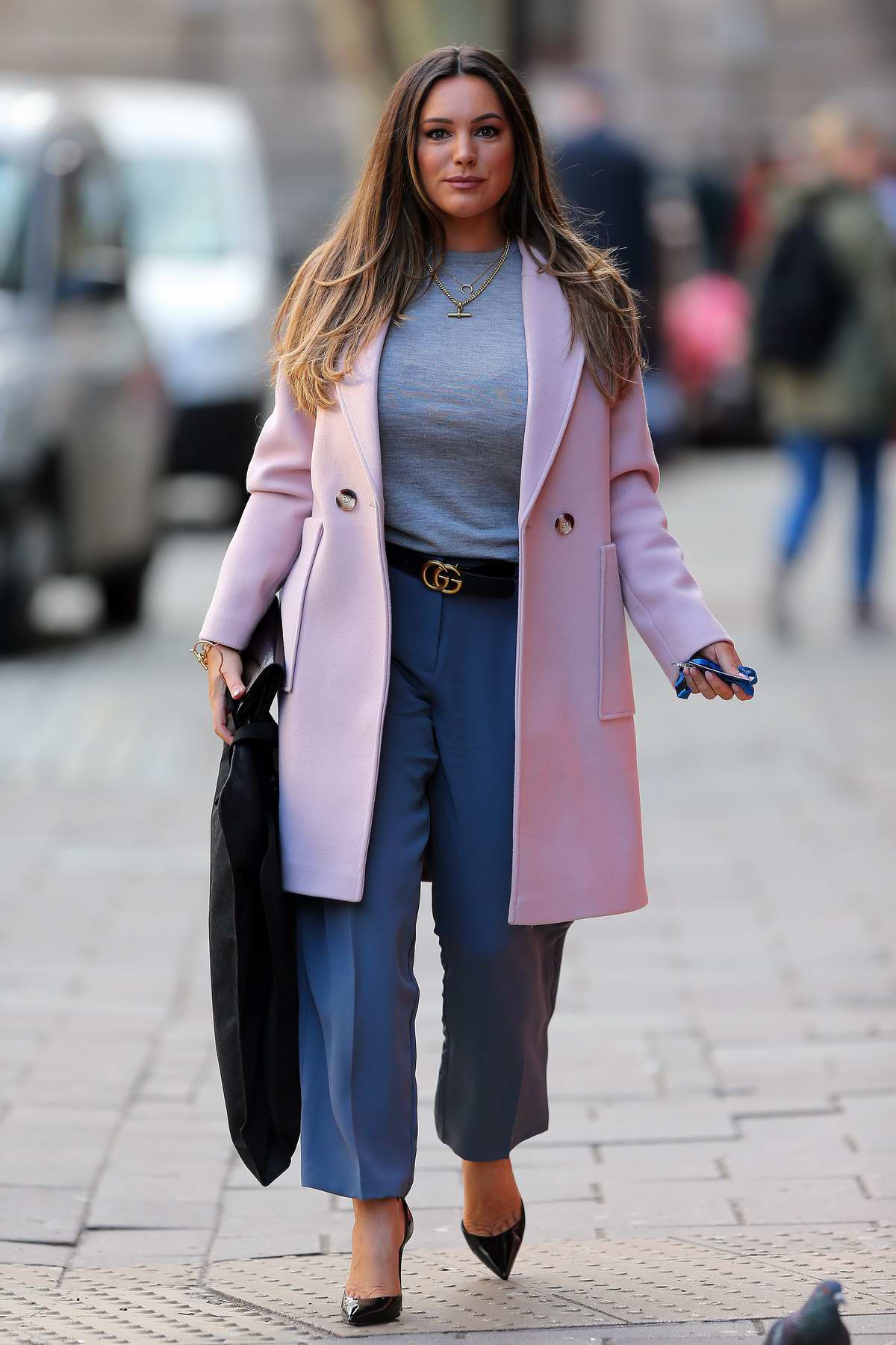 Kelly Brook looks lovely in pink coat as she leaves while out in London, UK