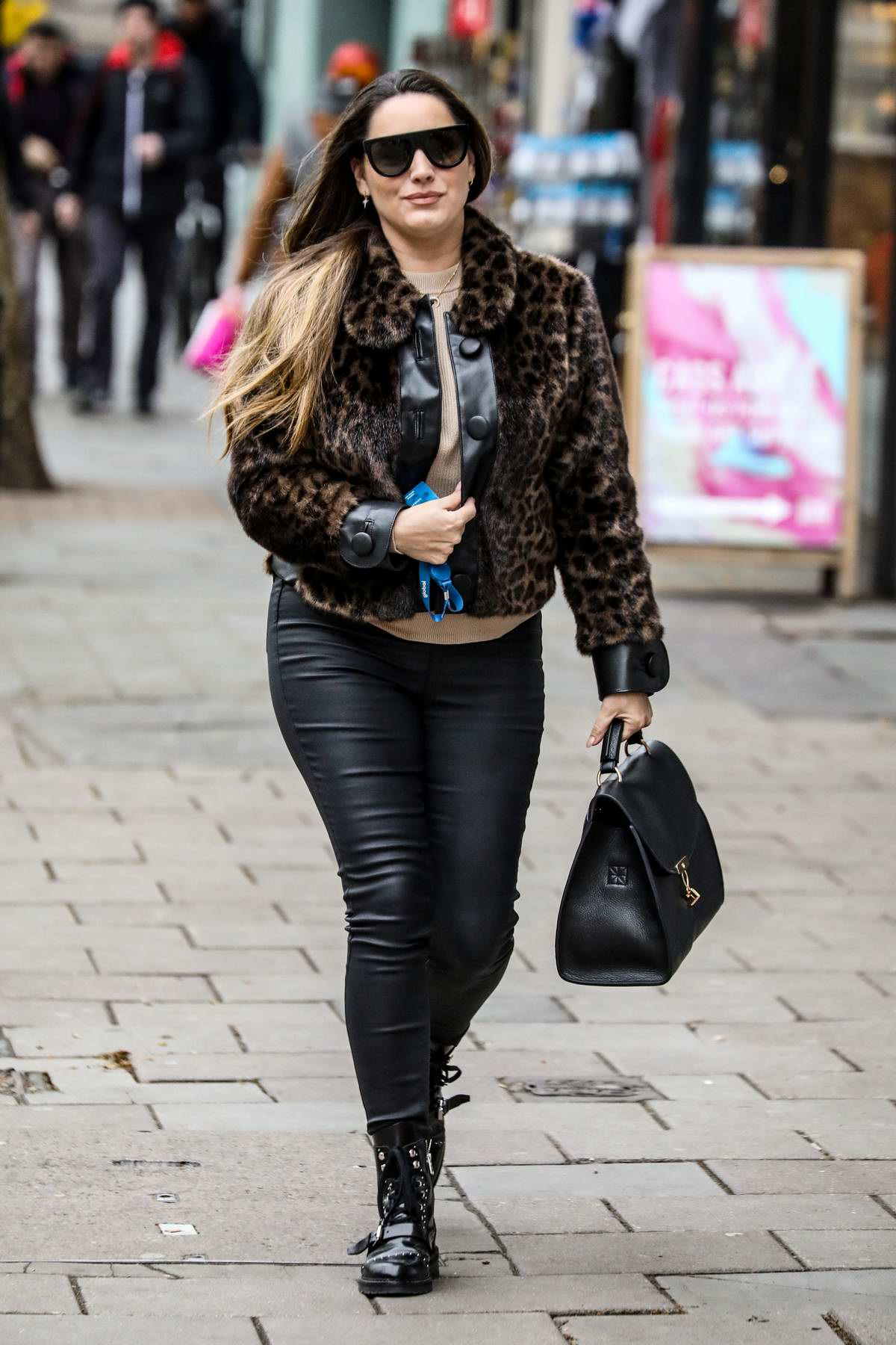 Kelly Brook looks stylish in an animal print jacket and black leather pants as she arrives at Global Radio in London, UK