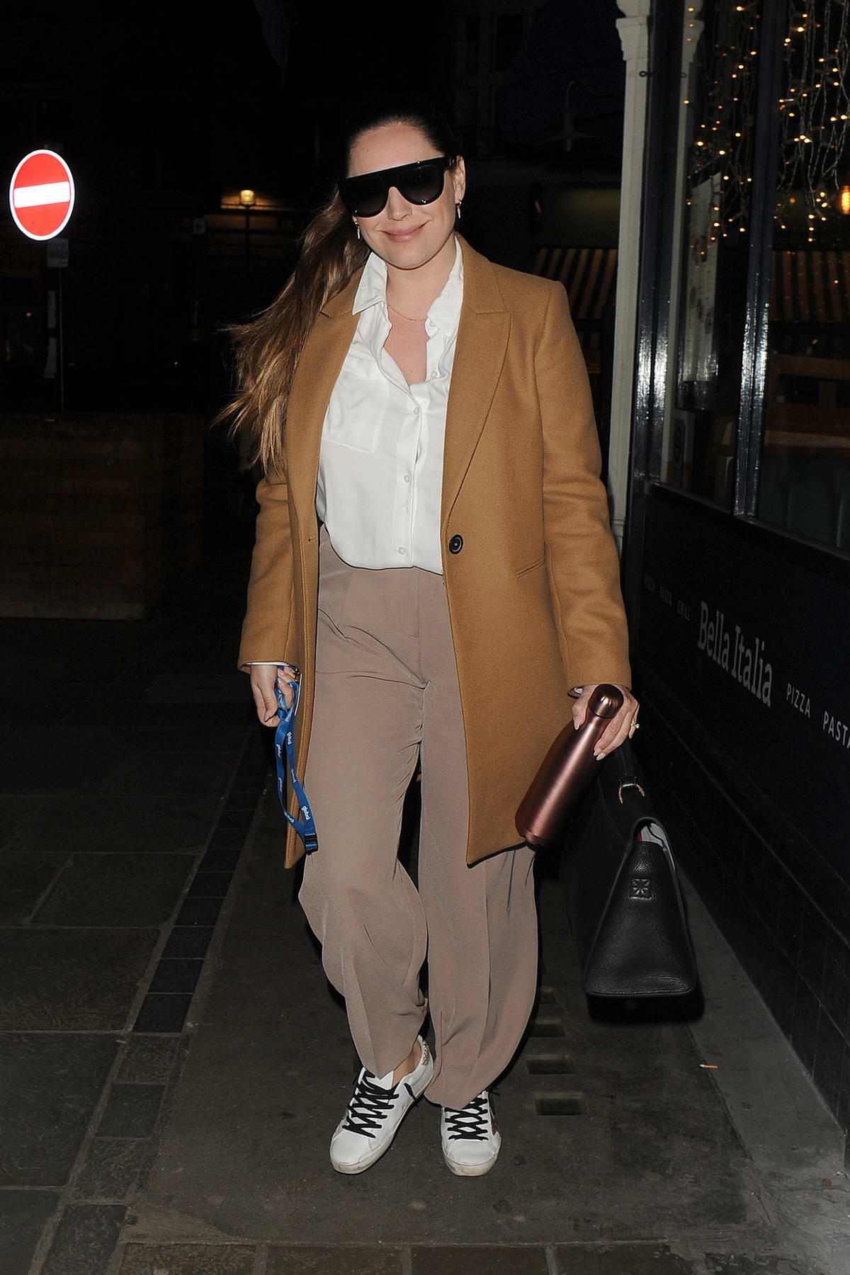 Kelly Brook seen wearing camel-colored blazer as she leaves Heart FM Studios in London, UK