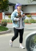 Kelly Osbourne carries her pup while leaving her brother Jack's house in Los Angeles