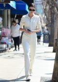 Kendall Jenner rocks a white jumpsuit as she stops by a local dry cleaner while out for breakfast in Studio City, California