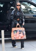 Kim Kardashian dons all-black leather ensemble and long multiple braids while out in Paris, France