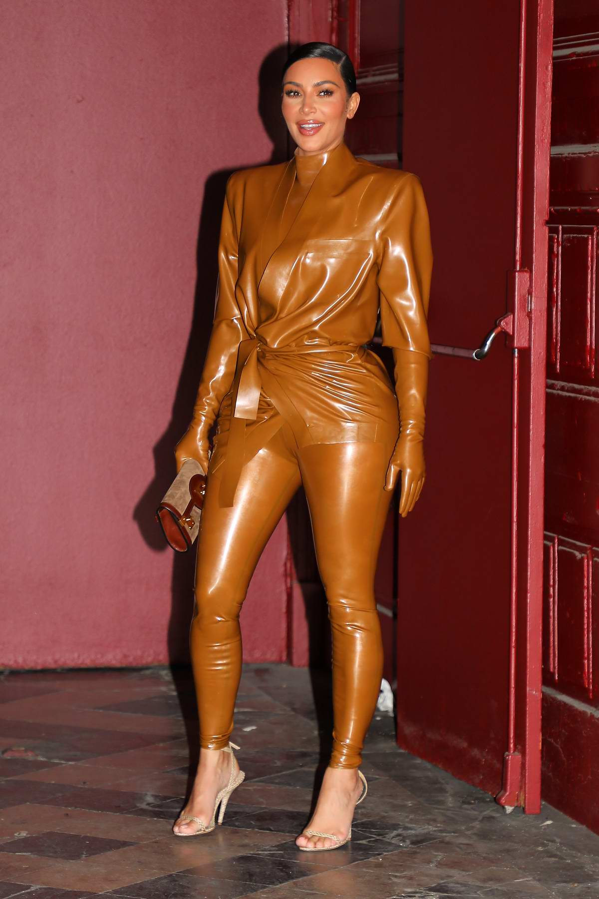 Kim Kardashian dons Balmain latex outfit as she steps out after Kanye's Sunday Service in Paris, France