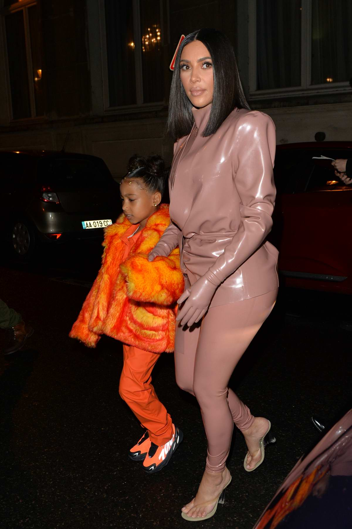 Kim Kardashian rocks her third Balmain latex outfit as she and Kourtney enjoy some family time with the kids in Paris, France