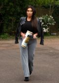 Lauren Goodger picks up a roll of toilet paper on her way home in London, UK