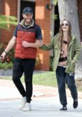 Lily Collins is all smiles as she takes her dog out for a walk with boyfriend Charlie McDowell in Los Angeles