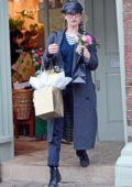 Lily James seen while shopping gifts and flowers in London, UK