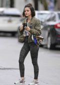 Lucy Hale looks great in camo leggings with a white top and olive green jacket as she hits the gym in Los Angeles