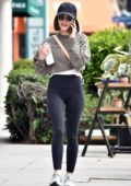 Lucy Hale sports a cropped grey sweatshirt and black leggings while heading to the gym in Studio City, California