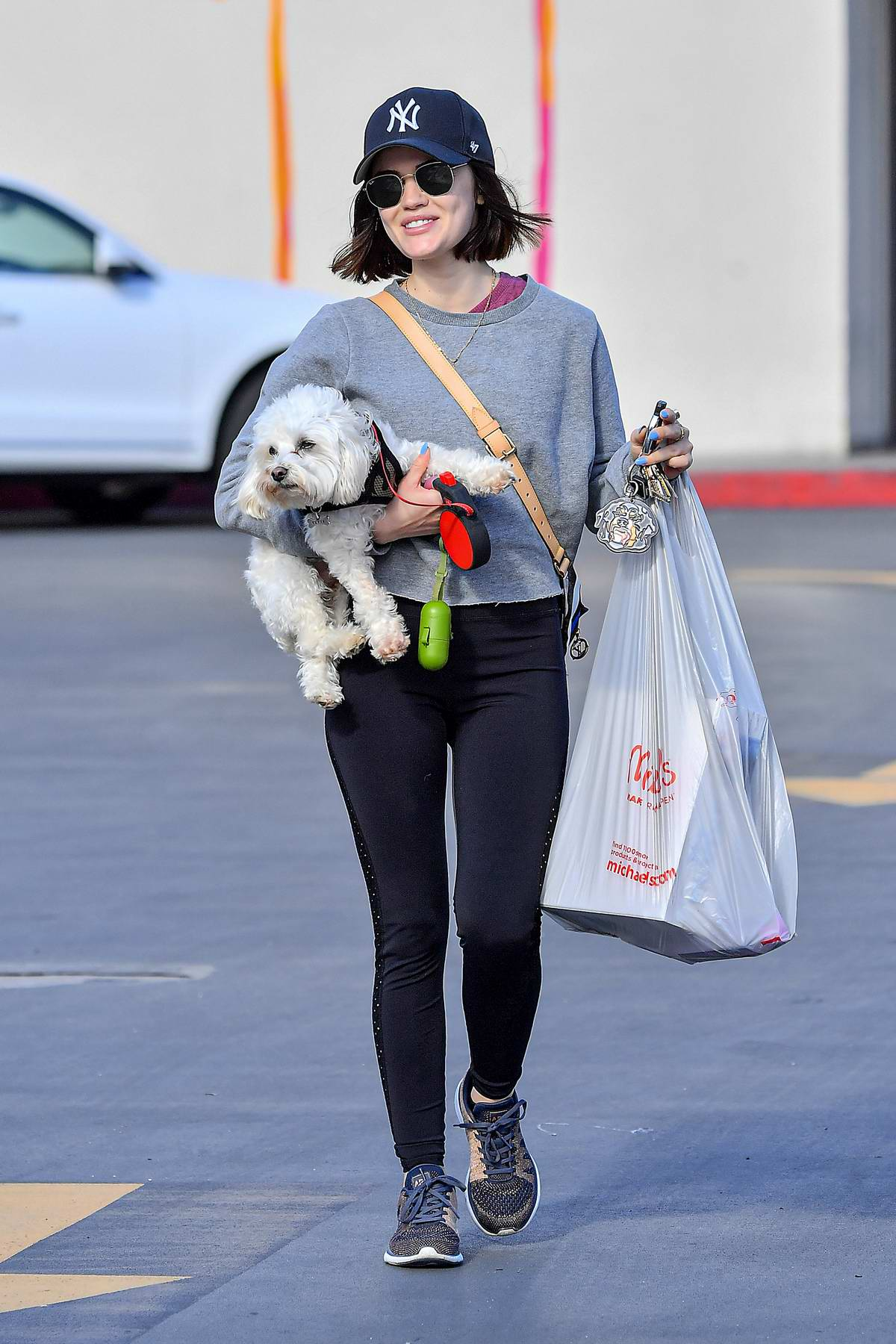 Lucy Hale stops to pickup some supplies before taking her dog out for a walk in Studio City, California