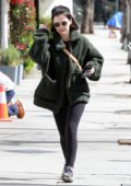 Lucy Hale wears a green teddy jacket and leggings during a coffee run at Alfred Coffee in Studio City, California