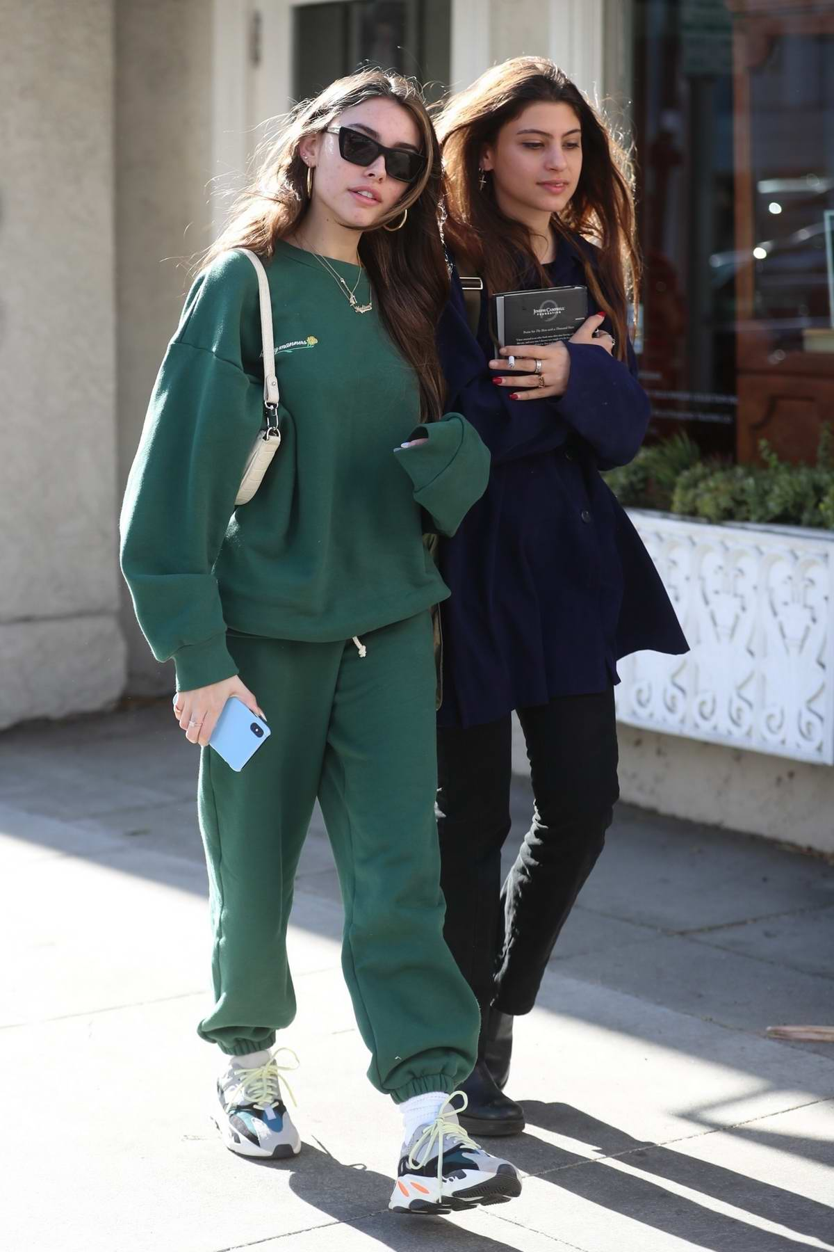 Madison Beer looks comfy in green sweatsuit while out for lunch with friends at Croft Alley in Beverly Hills, California