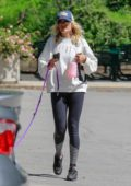Malin Akerman sports a white sweatshirt and leggings for stroll with her dog at Griffith Park in Los Angeles