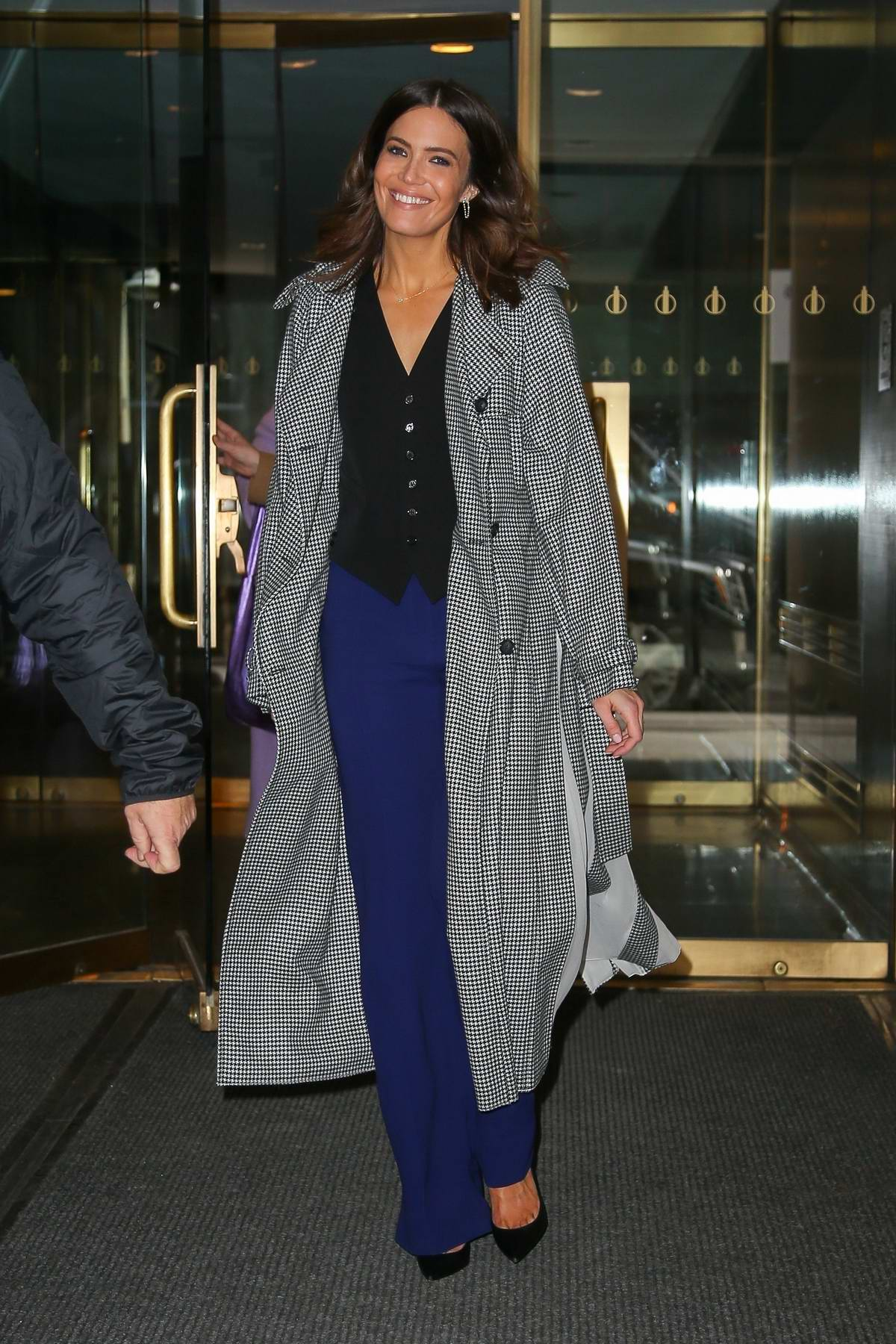 Mandy Moore looks stylish in a checkered grey long coat as she leaves NBC Studios in New York City