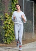 Margaret Qualley dresses down in grey sweats while out for a jog before grabbing breakfast in Los Angeles