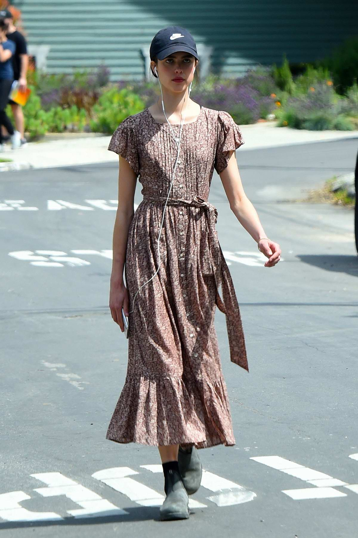 Margaret Qualley takes a break from quarantine to go for a walk in a floral print dress in Los Angeles