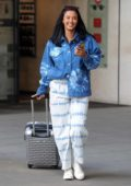 Maya Jama looks stylish in a tie-dye jean shirt and white patterned pants while leaving BBC Radio One Studios in London, UK