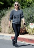Molly Sims seen wearing a grey sweatshirt and black leggings during a morning walk in Brentwood, California